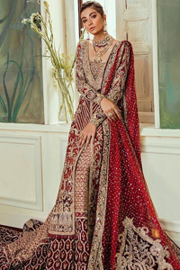 Chic, sleek and undeniably romantic, this beautiful deep red gown might just be the one for you. With pure fabric heavily laden with zardozi and the perfect blend of traditional flamboyance and modern elegance in design, you need to look no further for the perfect look for your special day. The bodice is heavily decorated with zardozi work, the rest of the gown is enriched with floral bootis and finished with the thick embellished bottom. Complete the look with an artfully coordinated lehenga which is ornamented with geometric patterns and captivating back trail design with traditional intricate embroidery. The outfit is coordinated with an organza dupatta finessed with embroidered borders.