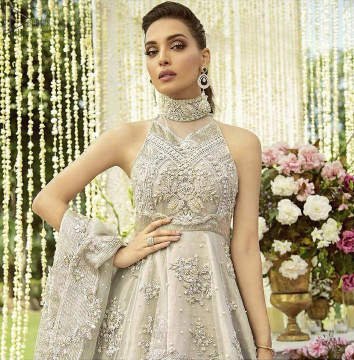 the peplum is emphasized with a delicate arrangement of hand-embellished floral bunches and scattered sequins spray all over.