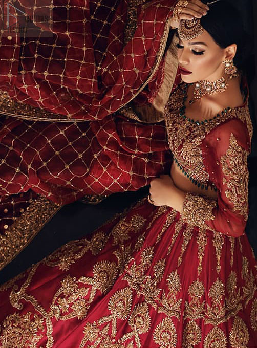 Poise, Beauty, and Charm. Feel pampered in this finely handcrafted celestial-inspired ensemble, deftly ornamented with intricate hand-embroidery. Fitted red blouse with cross-check pattern work and solid embroidery. Pakistani bridal dress comes with a large flare lehenga having multiple panelled embroideries.  Pure Organza dupatta has heavy four-sided borders and cross-checks pattern embroidery.
