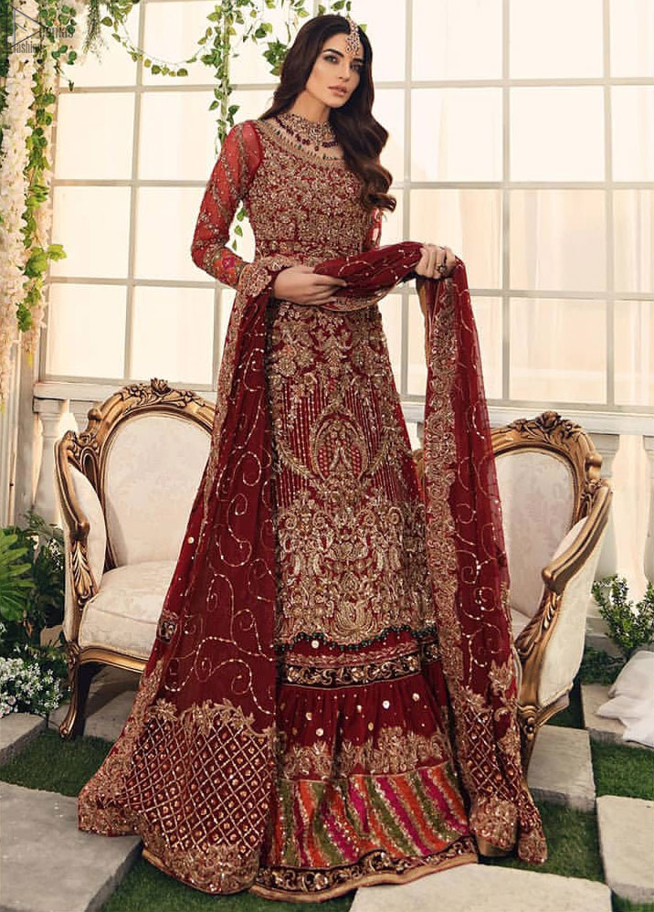Bridal Wear Maroon Shirt n Dupatta – Chatta Patti Gharara. Framed in a Beautiful Shirt and Dupatta both in the same Maroon colour along Chatta Patti Lehenga is One To Wear. Multicolour copper embroidery on Shirt and Lehenga is fully embellishing with Appliques, Sequins, Tilla and Dabka work. Plus on Duppata too of Organza fabric same as that of Shirt and Lehenga which is fully sprayed with sequins and Tilla work. Along with finished edges and fixed waist belt with side zip closure. The shirt is with a round neckline and full Sleeves which are in full length; too completely engraved with embroidery plus floral motifs on Dupatta increasing the whole gorgeousness.