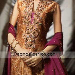 Pure Banarsi Rust shirt has been endowed with elevated embroidery on sherwani collar neckline and heavily embroidered border on hemline, appliqued on the hem in magenta.